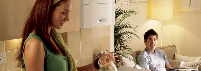 Couple shown in kitchen with boiler